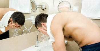 guy washing face and beard