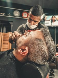 stylist trimming beard